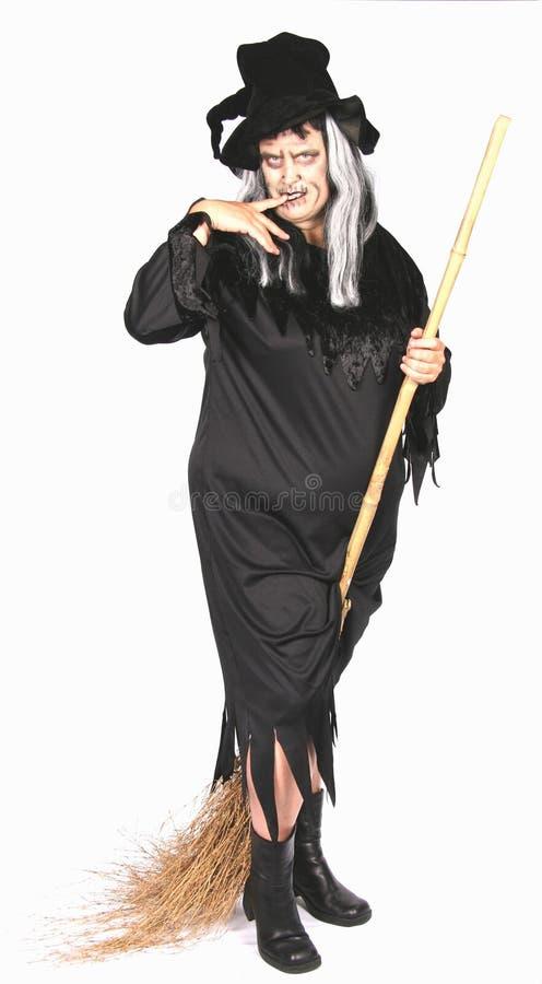 Mulher vestida como uma bruxa feia imagens de stock