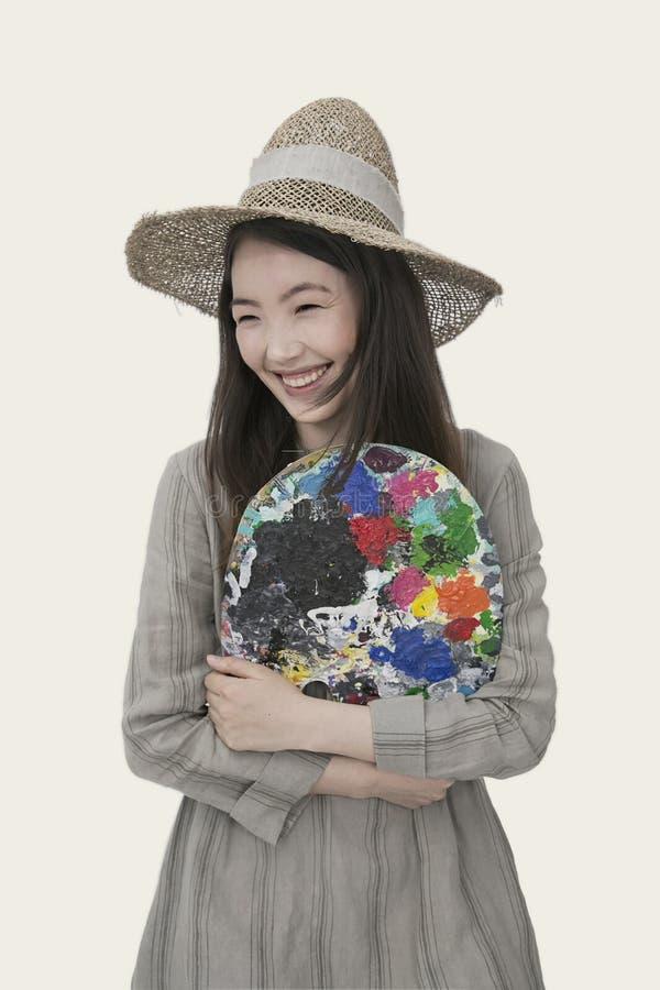 Mulher vestindo chapéu de sol castanho e vestimenta comprida de manga comprida fotos de stock