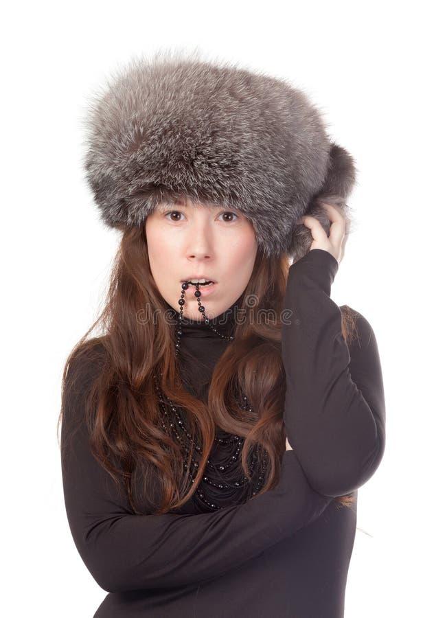 Mulher Vivacious no equipamento do inverno fotografia de stock royalty free
