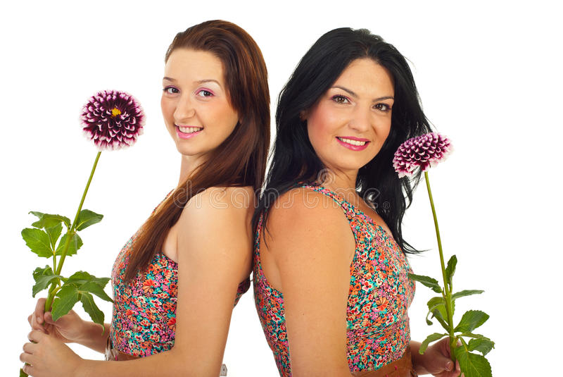 Mulheres bonitas que prendem flores imagens de stock