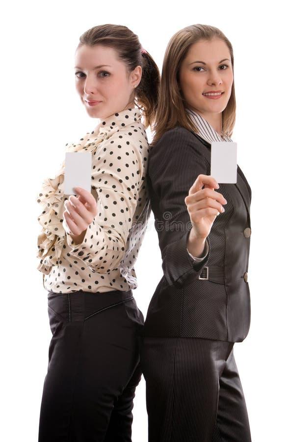 Mulheres com cartões. Isolado no branco imagens de stock royalty free