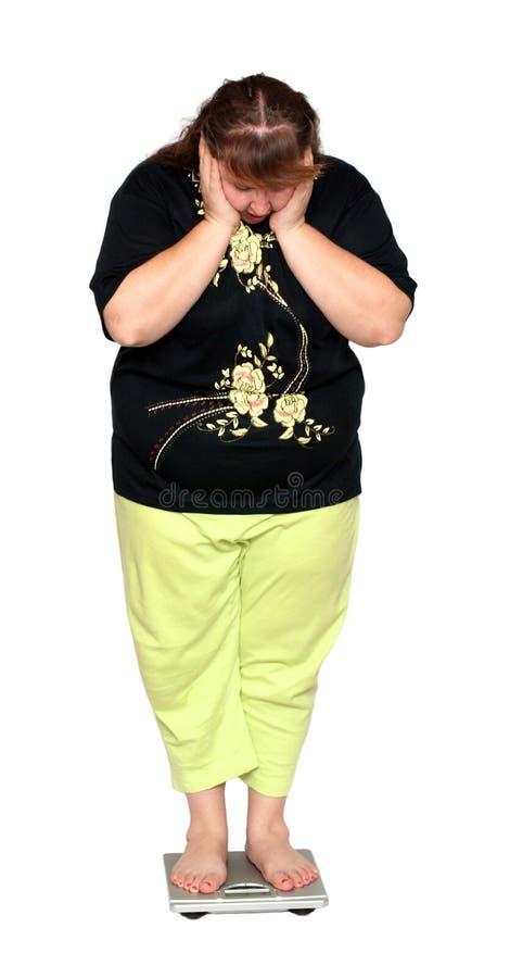 Mulheres com escalas do excesso de peso fotografia de stock
