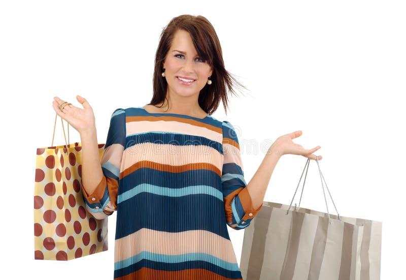 Mulheres da compra que sorriem sobre o backg branco imagem de stock royalty free