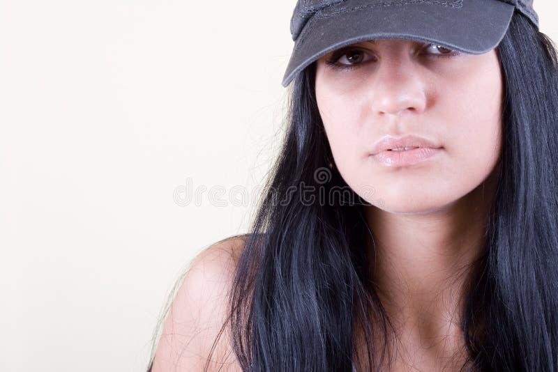 Mulheres de Blackhair no tampão do esporte imagem de stock