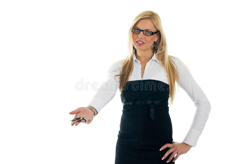 Mulheres de negócio novas que dão afastado chaves fotos de stock