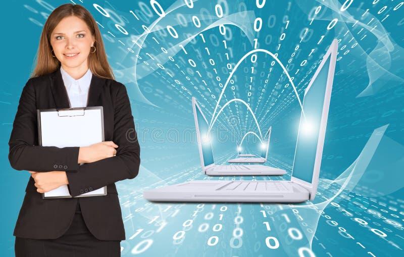 Mulheres de negócios com portáteis fotos de stock