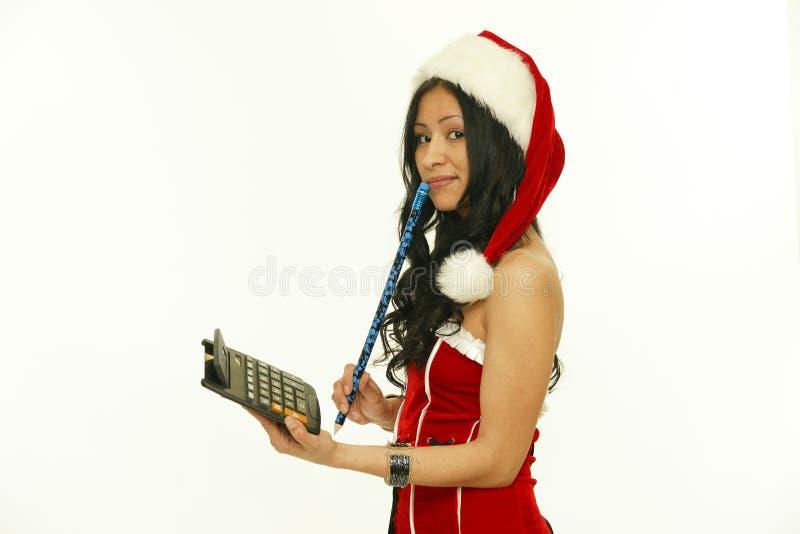 Mulheres de Santa com sacos menina modelo asiática da beleza no traje de Santa com calculadora fotografia de stock