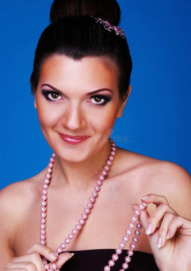 Mulheres do encanto no azul imagens de stock royalty free