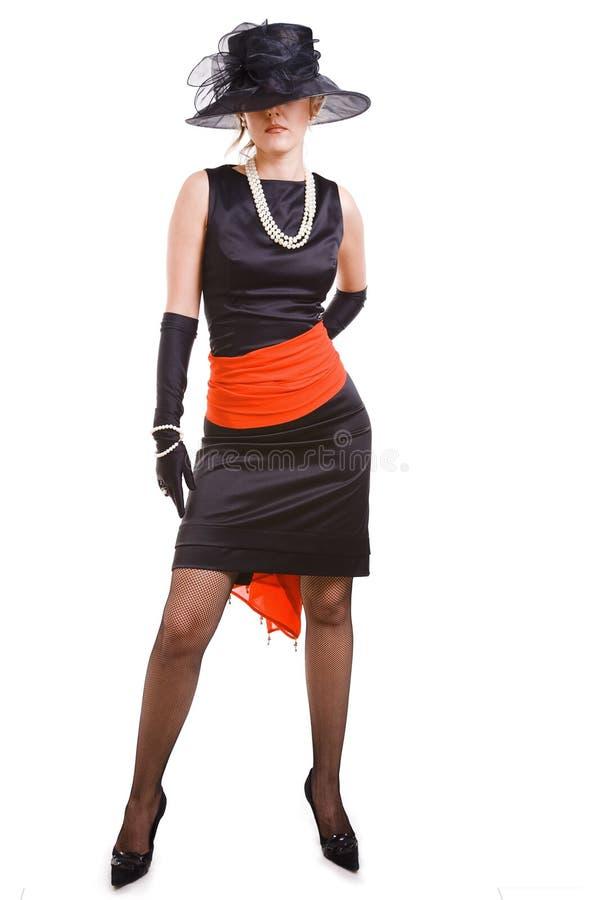 Mulheres em preto e no vermelho imagens de stock