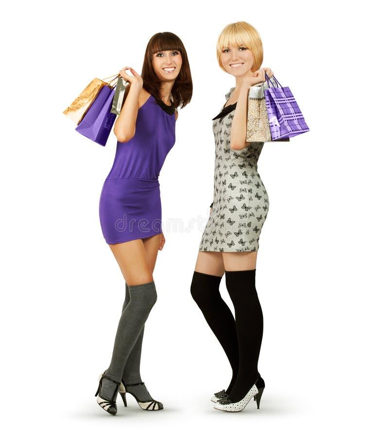Mulheres felizes que prendem sacos de compra imagens de stock royalty free