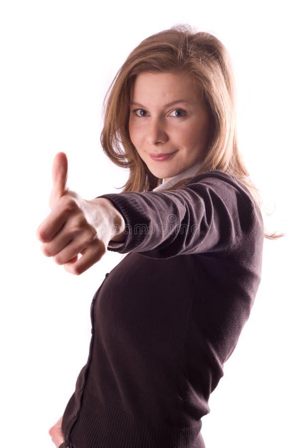 Mulheres novas que mostram os polegares acima fotografia de stock royalty free