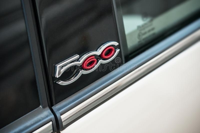Retail of Fiat 500 logo on pearly beige car parked in the street. Mulhouse - France - 6 April 2018 - retail of Fiat 500 logo on pearly beige car parked in the royalty free stock image