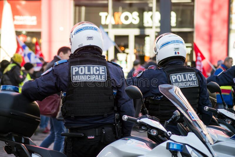 French municipal police on motorbike looking demonstration against pension reforms in the street stock photos