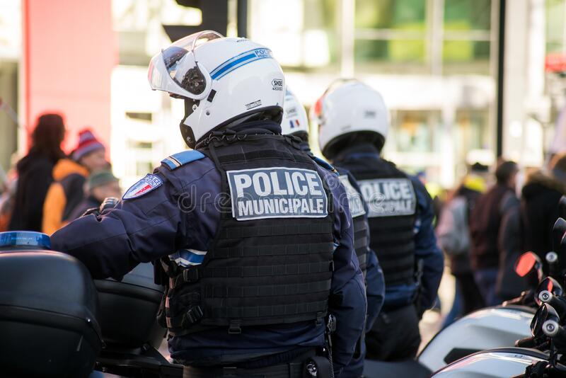 French municipal police on motorbike looking demonstration against pension reforms in the street stock images