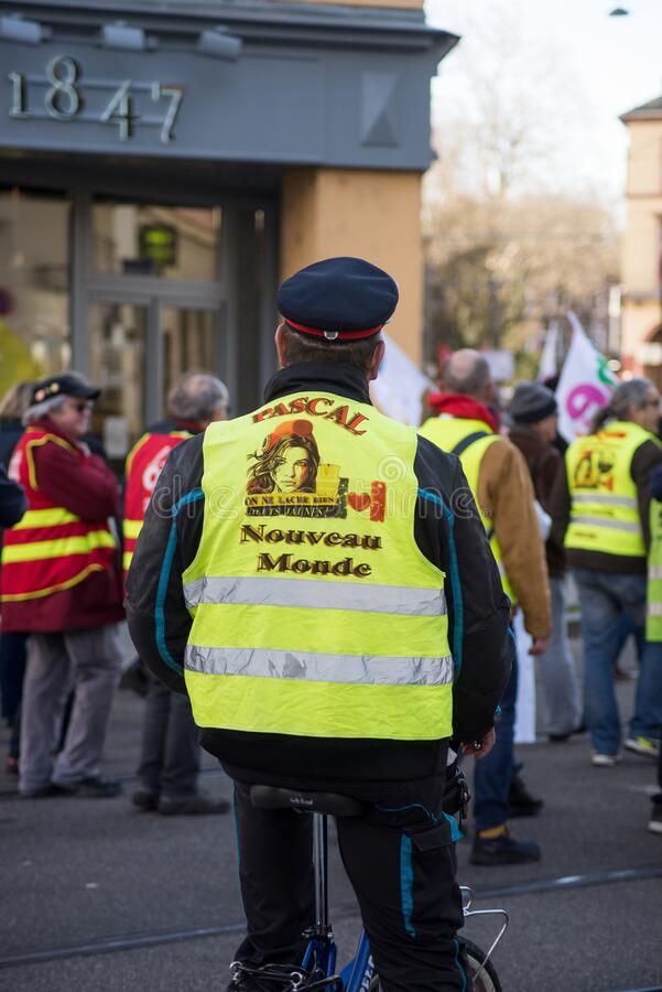 Man with yellow vest and bicycle protesting against the pension reform from the government royalty free stock photos