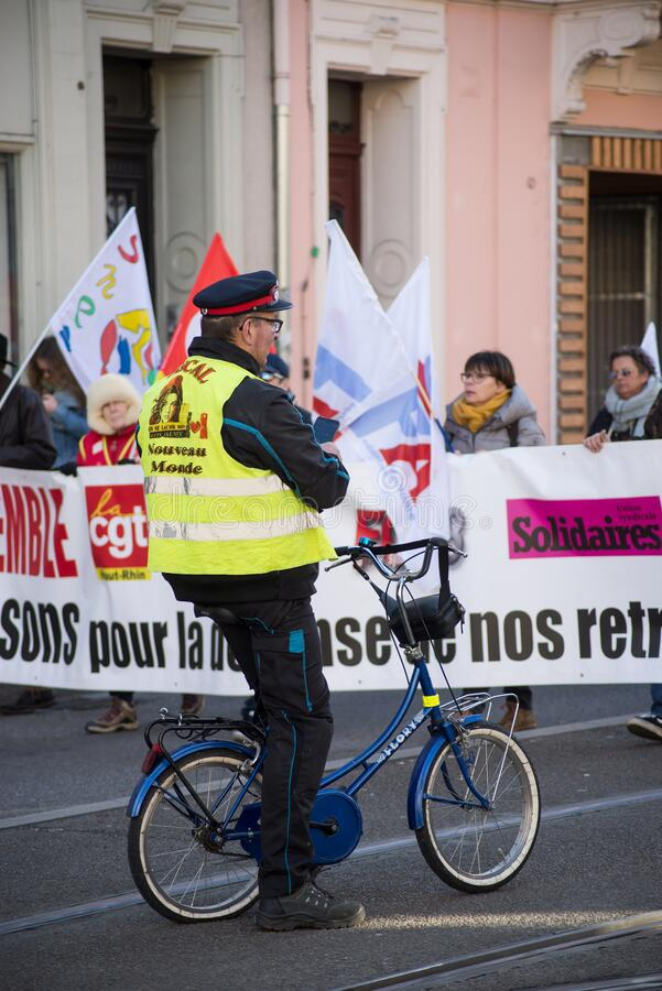 People with yellow vest and bicycle protesting against the pension reform from the government stock photography