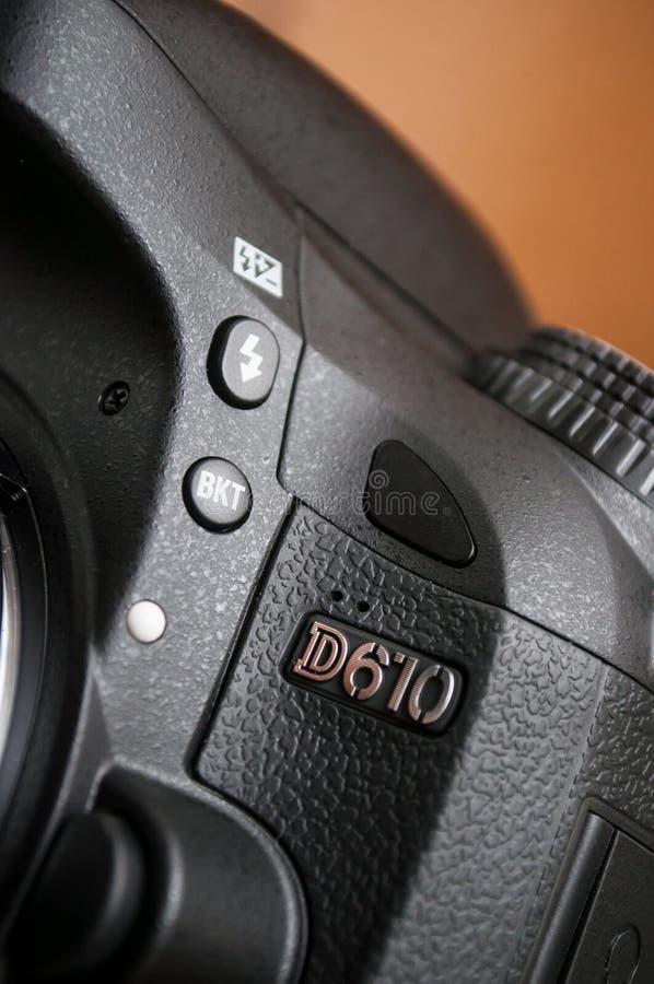 Nikon D610 reflex Full Frame on brown background. Mulhouse - France - 6 January 2020 - Closeup of Nikon D610 reflex Full Frame on brown background stock photography