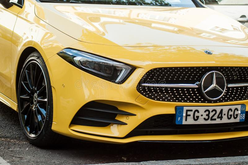 closeup of yellow coupe mercedes Benz car front parked in the Street royalty free stock photography