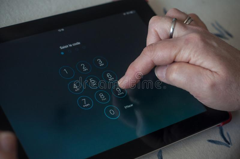 Closeup of woman hands on identification code page on tablet royalty free stock photo