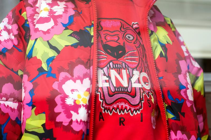 Colorful clothes fron Kenzo brand in a luxury  fashion store showroom. Mulhouse - France - 13 October 2019 - Closeup of colorful clothes fron Kenzo brand in a royalty free stock photo