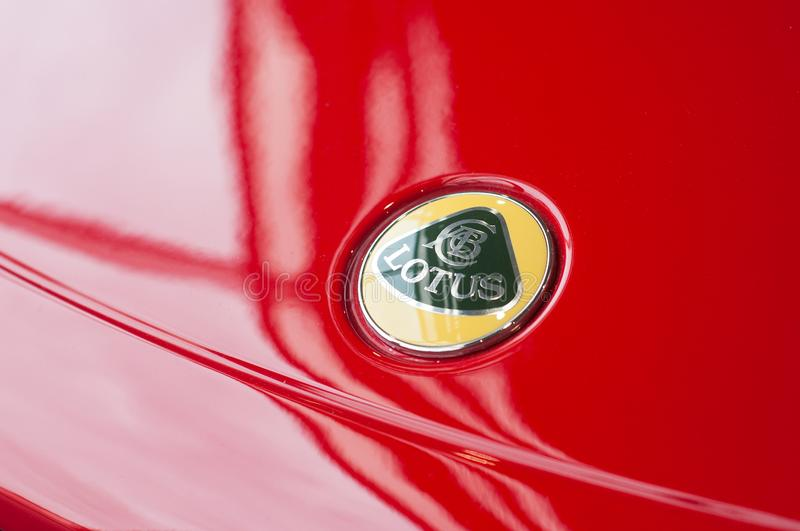 Logo on red Lotus Elise at retailer showroom. Mulhouse - France - 9 October 2019 - Closeup of logo on red Lotus Elise at retailer showroom stock photo