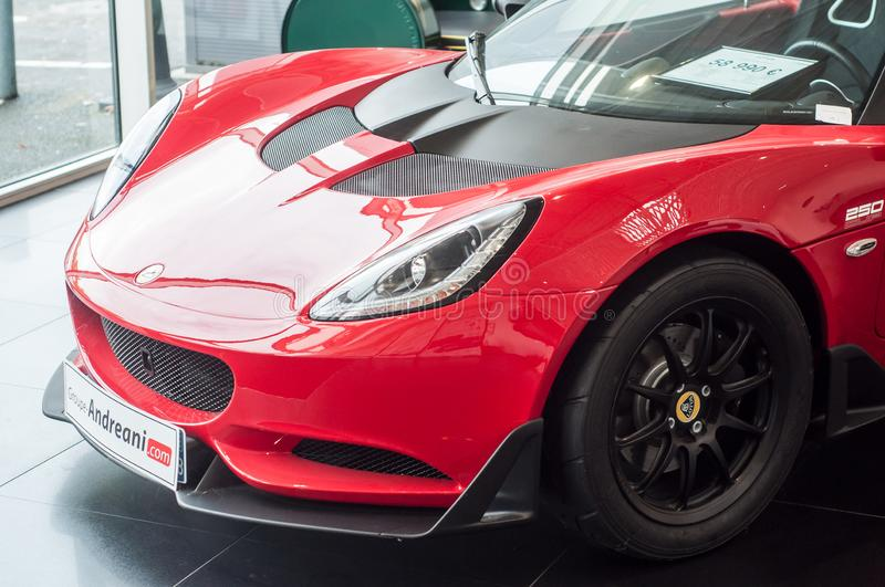 Red Lotus Elise front at retailer showroom. Mulhouse - France - 9 October 2019 - Closeup of red Lotus Elise front at retailer showroom royalty free stock photos