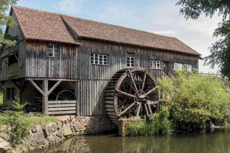 Old traditional water mill made in wood in the Eco Museum of Alsace near Mulhouse in France. Mulhouse France 10-15-2018. Old traditional water mill made in wood royalty free stock photography
