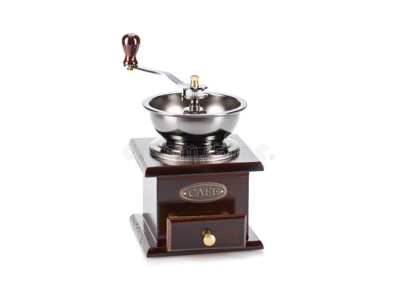 Mulino di caffè antico d'annata isolato su bianco fotografia stock