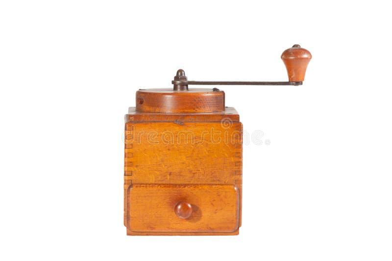 Mulino di caffè di legno marrone chiaro d'annata isolato su fondo bianco immagine stock libera da diritti