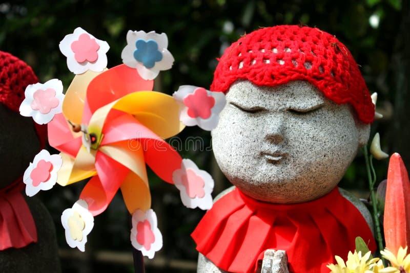 Mulino a vento e Buddha fotografia stock libera da diritti