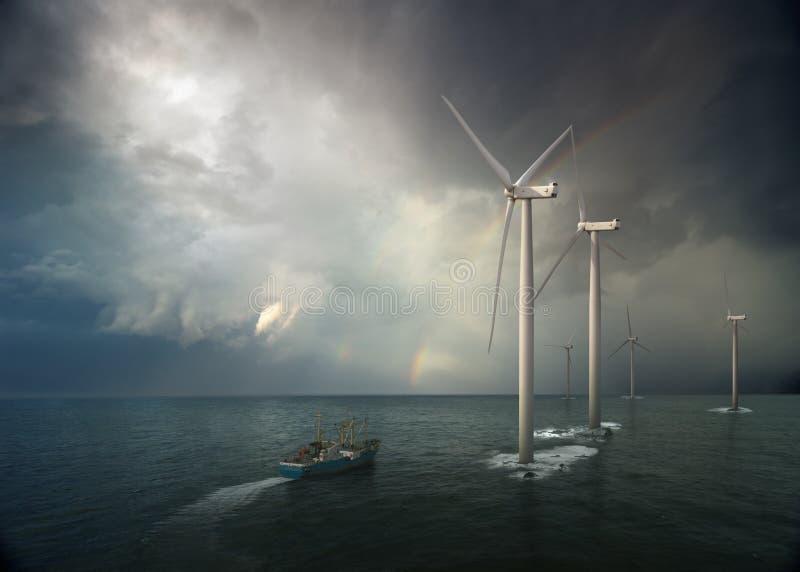 Mulino a vento in oceano immagini stock
