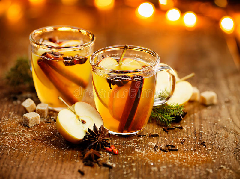 Mulled cider with addition of aromatic spices and citrus fruits. Hot cider with addition of cinnamon sticks, anise stars, cloves and citrus fruits. Delicious royalty free stock photography