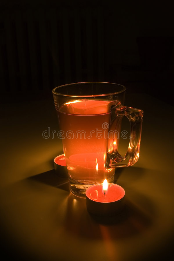 Mulled wine with candles. Lightpainting royalty free stock image