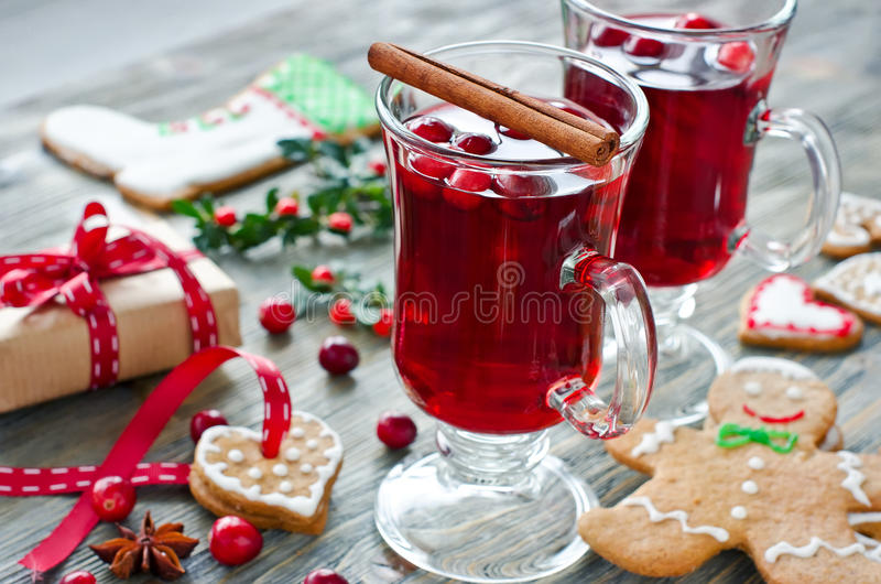 Mulled wine with cranberry and gingerbread cookies and gift box royalty free stock photos