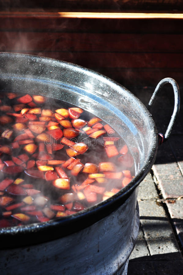 Mulled wine on fire. Mulled wine with lemon and spices on fire stock photo