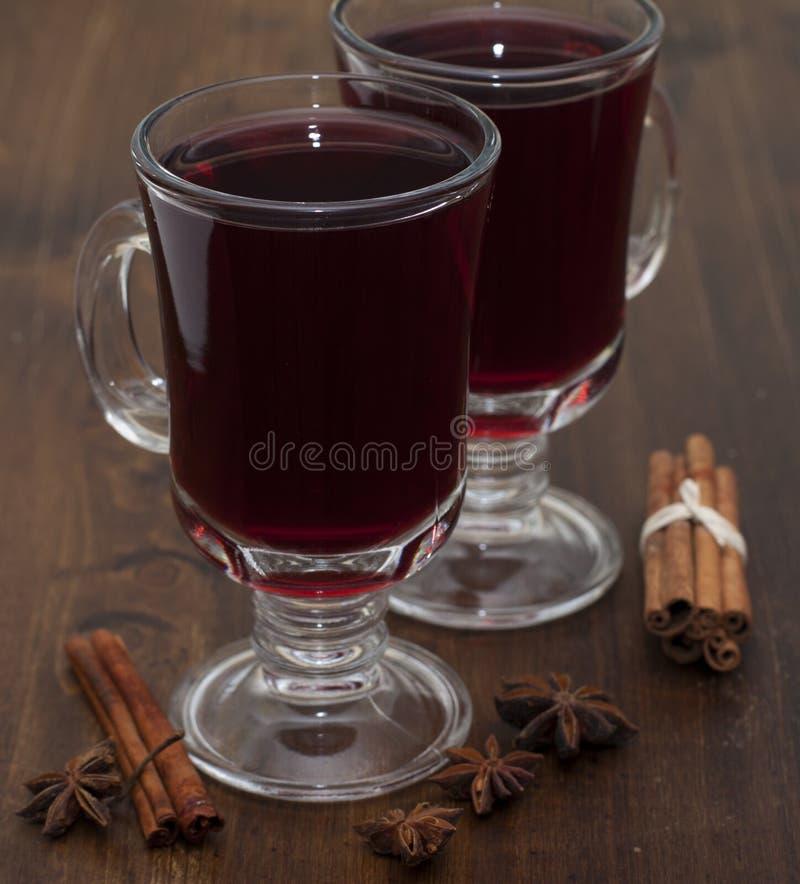 Mulled wine in glasses . Mulled wine in glasses with cinnamon on the table stock photo