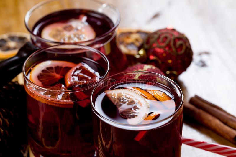 Mulled wine in glasses with spices on wooden background,top view stock image