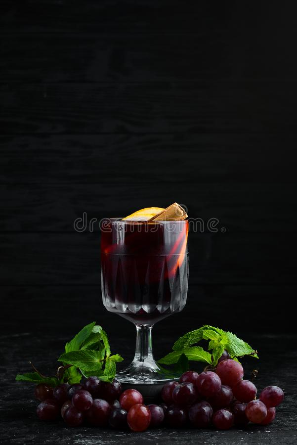 Mulled wine. Hot wine with orange, apple and cinnamon. In the glass. Top view. stock images