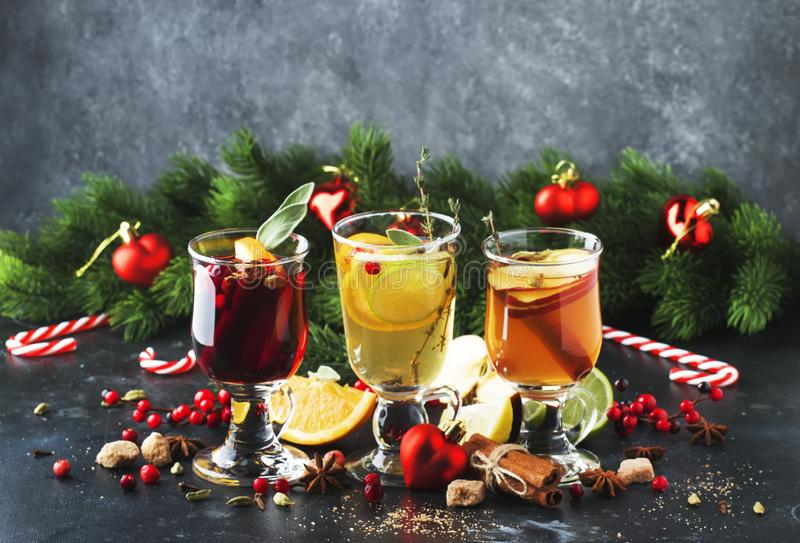 Mulled wine and mulled cider. Hot winter drinks and cocktails for christmas or new year`s eve in glass mugs with spices and citru. S fruit stock images