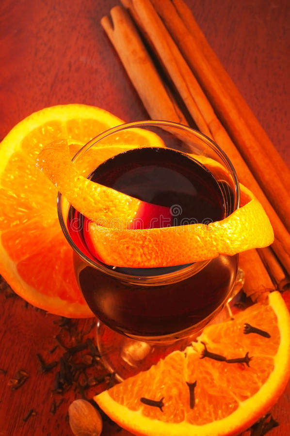 Mulled wine, orange and spices royalty free stock image