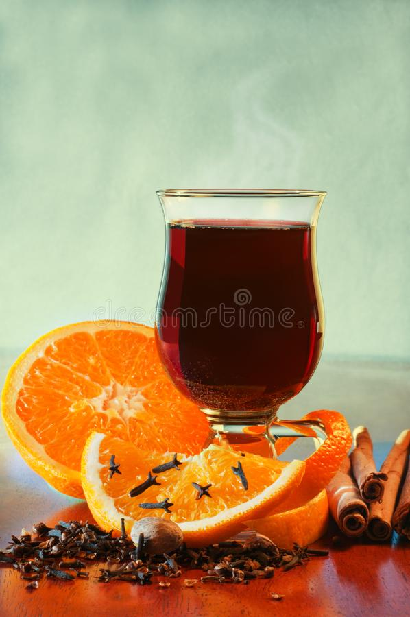 Mulled wine with orange and spices on the table royalty free stock photos