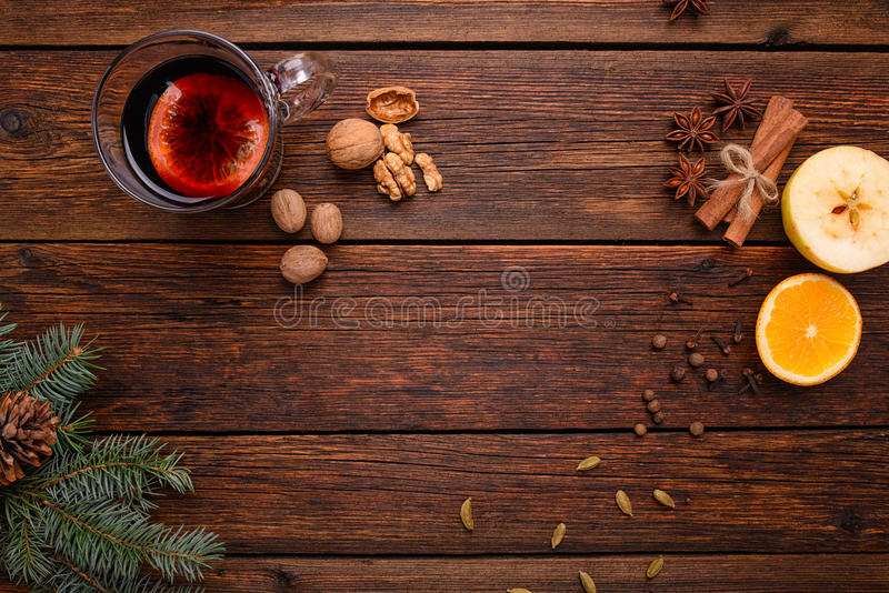 Mulled wine, punch and spices for glintwine on vintage wooden table background top view stock photos