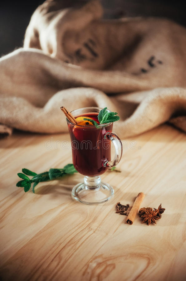 Mulled wine with slice of orange and spices. Shallow dof.  royalty free stock photo