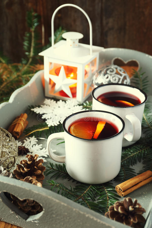Mulled wine with spices and citrus fruit royalty free stock photography
