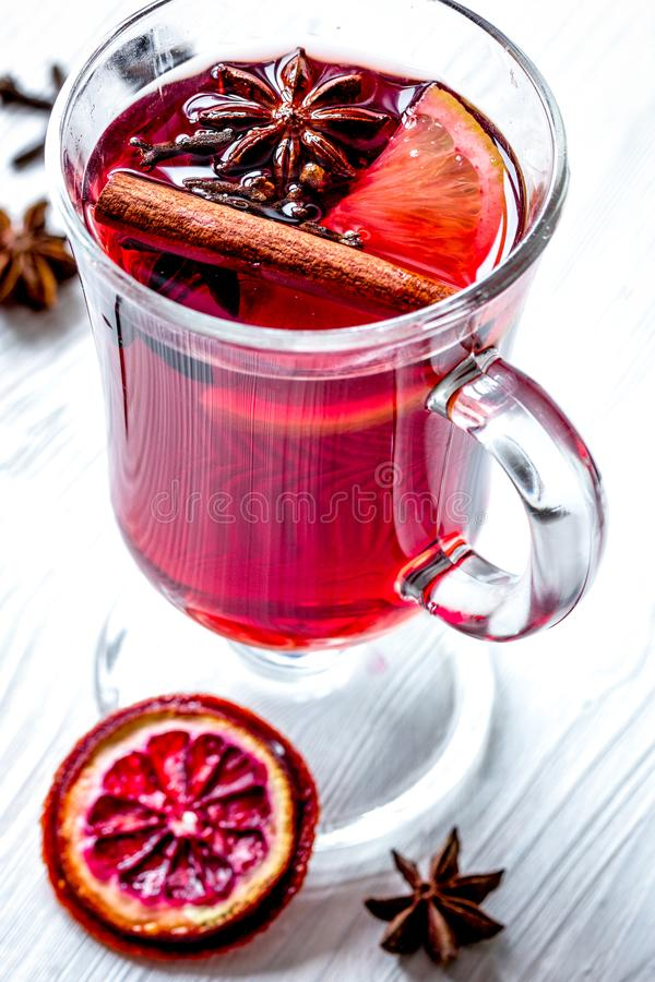 Mulled wine with spices in cup on wooden background.  royalty free stock images
