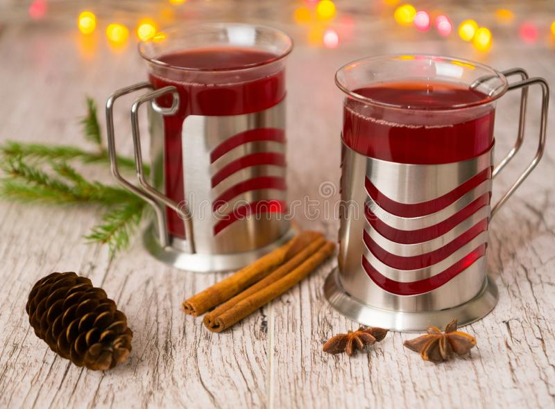 Mulled wine with spices, fir branch, cone and xmas lights stock photo