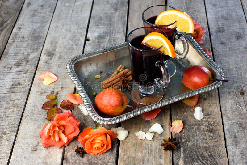 Mulled wine and spices on wooden background. royalty free stock photo