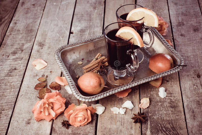 Mulled wine and spices on wooden background. stock image