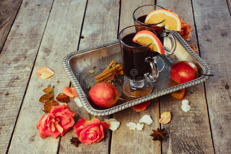 Mulled wine and spices on wooden background. royalty free stock image