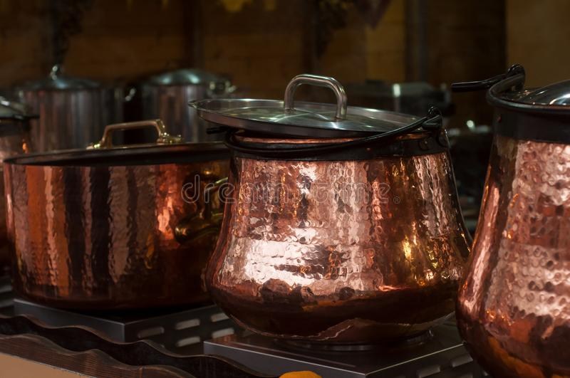 Mulled wine in traditional copper cauldron at the chr royalty free stock photography